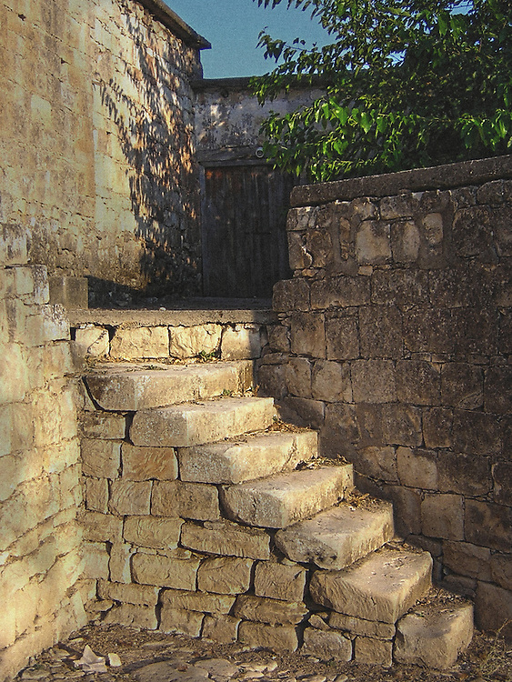 Old stone steps lading up to a house in Cyprus