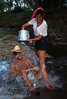 Couple Splashing And Playing In A Stream