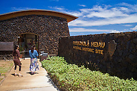 Two visitors entering the visitor center at Pu'ukohola Heiau National Historic Site, Kawaihae, Kohala, Big Island.