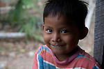 Belizean boy in the window of his home near Punta Gorda, Beliza