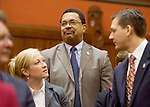 HARTFORD, CT- 07 JANUARY 2008 --010709JS05-Rep. Larry B. Butler, D-72nd District, center, stands as his name is called during roll call Wednesday at the opening day of the general assembly at the state Capitol in Hartford. <br /> Jim Shannon / Republican-American