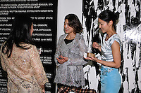 Fashion designer Yuna Yang speaks with members at the 85 Broads presentation of the Yuna Yang trunk show at Art Gate Gallery on October 24th 2011.