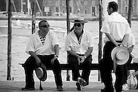 Three gondoliers taking a break, Venice, Italy