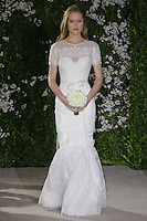 Model walks runway in an Erin wedding dresses by Carolina Herrera, for the Carolina Herrera Bridal Spring 2012 runway show.
