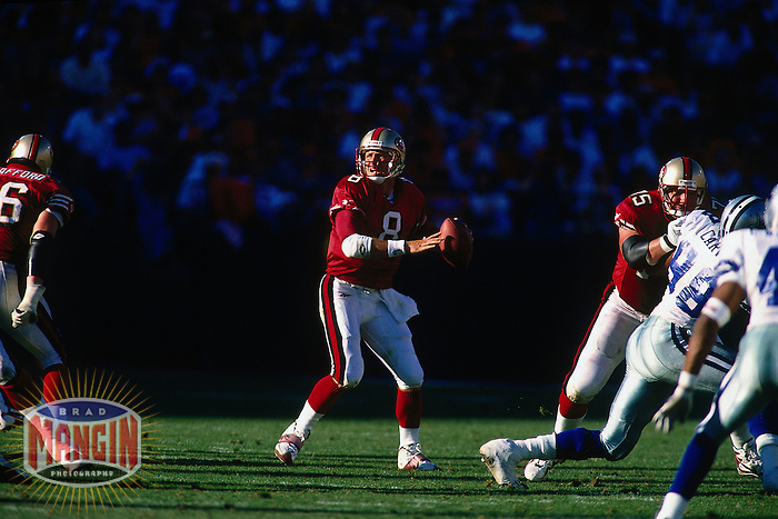 SAN FRANCISCO, CA - Quarterback Steve Young of the San Francisco 49ers in action during a game against the Dallas Cowboys at Candlestick Park in San Francisco, California in 1997. Photo by Brad Mangin