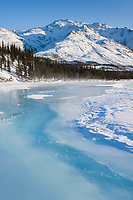 Overflow ice on the Koyukuk river, Shell mountain of the Brooks range in the distance.