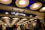 Queues of newly-arrived airline passengers line up at the UK Border Agency's passport control at Heathrow Airport T5