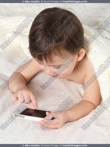 Two year old boy using an iPhone