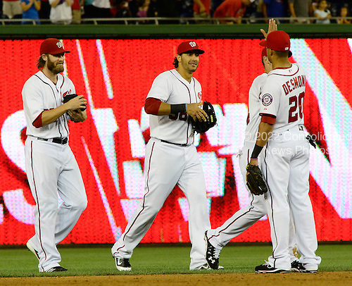 Washington Nationals left fielder Michael Morse (38), center, celebrates his team's 6 - 4 victory over the New York Mets with teammates Jayson Werth (28), left, and Ian Desmond (20), right, at Nationals Park in Washington, D.C. on Friday, August 17, 2012.  Morse hit a fourth inning grand slam home run.  The Nationals won the game 6 - 4..Credit: Ron Sachs / CNP.(RESTRICTION: NO New York or New Jersey Newspapers or newspapers within a 75 mile radius of New York City)
