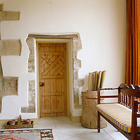 Exposed stone detailing frames the entrance to the main living area