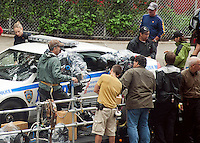 "Leelee Sobieski enters an NYPD police car as  production crew prepares the set on a trailer for a shot in traffic, seen in the Chelsea neighborhood of New York on Wednesday, September 7, 2011. The production is for the Robert DeNiro produced television show ""The 2-2"". (© Richard B. Levine)"