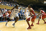 17 November 2013: Duke's Chelsea Gray (left) drives past Alabama's Shafontaye Myers (right). The Duke University Blue Devils played the University of Alabama Crimson Tide at Cameron Indoor Stadium in Durham, North Carolina in a 2013-14 NCAA Division I Women's Basketball game. Duke won the game 92-57.