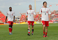 Toronto FC defender Doneil Henry #4,Toronto FC forward Nick Soolsma #18 and Toronto FC defender Dan Gargan #8 walk off the pitch after warm-ups during an MLS game between the FC Dallas and the Toronto FC at BMO Field in Toronto on July 20, 2011..FC Dallas won 1-0.