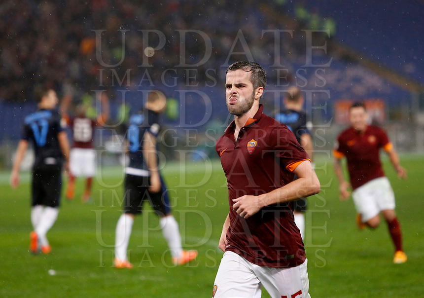 Calcio, Serie A: Roma vs Inter. Roma, stadio Olimpico, 30 novembre 2014.<br /> Roma&rsquo;s Miralem Pjanic celebrates after scoring on a free kick his second goal during the Italian Serie A football match between AS Roma and FC Inter at Rome's Olympic stadium, 30 November 2014.<br /> UPDATE IMAGES PRESS/Riccardo De Luca