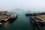 A view at sunrise of Riva degli Schiavoni with San Giorgio Maggiore in the background. Taken about 30 minutes after sunrise on a foggy morning of January, this is stitched from six vertical frames.
