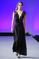 Model walks the runway in an outfit from the Pietra Pizzaro Fall 2012 The Future Feminine collection, by Pietra Banchi and Susan Pizarro-Ekert, during Couture Fashion Week New York, February 17, 2012.