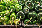 Spicy green peppers piled up at market