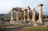 CORINTH, GREECE - APRIL 16 : A general view of the Temple of Apollo, on April 16, 2007 in Corinth, Greece. Standing prominently on a knoll the Temple of Apollo was built in the 7th century BC in the Doric Order. Seven of its original 38 columns remain standing and are seen here in the early morning light with the mountains in the background. It is one of the oldest temples in Greece. Corinth, founded in Neolithic times, was a major Ancient Greek city, until it was razed by the Romans in 146 BC. Rebuilt a century later it was destroyed by an earthquake in Byzantine times.(Photo by Manuel Cohen)