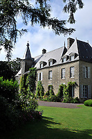 The imposing grey stone walls of the 19th century chateau de Saint-Paterne in Normandy