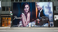 Shoppers pass a billboard for a new Baccarat jewelry store on Fifth Avenue in New York during the Christmas shopping season on Saturday, December 1, 2012. (© Richard B. Levine)