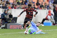 Houston, TX - Friday December 9, 2016: Bryce Marion (7) of the Stanford Cardinal jumps over Walker Hume (37) of the North Carolina Tar Heels at the NCAA Men's Soccer Semifinals at BBVA Compass Stadium in Houston Texas.