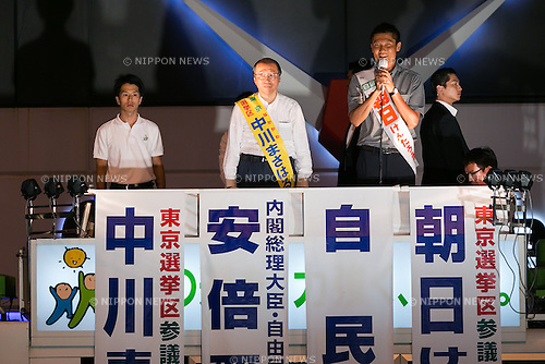 (L to R) Liberal Democratic Party candidates Masaharu Nakagawa and Kentaro Asahi, speak during a campaign event in Akihabara on July 9, 2016, Tokyo, Japan. Shinzo Abe, leader of the Liberal Democratic Party and Prime Minister of Japan delivered his last campaign speech before the July 10th House of Councillors elections. (Photo by Rodrigo Reyes Marin/AFLO)