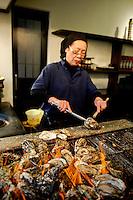 Miyajima Island, where Itsukushima shrine,Tori gate, is. Barbeques oysters, a typical dish here.