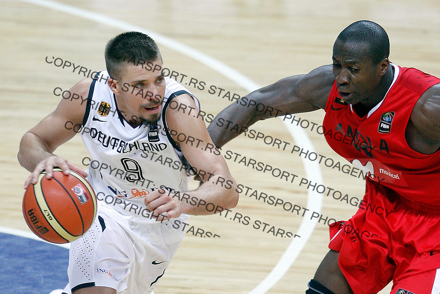 Steffen HAMANN (Germany) dribbles Eduardo MINGAS (Angola)  during the World championship basketball match against Angola in Kayseri, Germany-Angola, Turkey on Wednesday, Sep. 01, 2010.(Novak Djurovic/Starsportphoto.com).