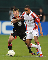 Toronto FC forward Ryan Johnson (9) shields the ball against D.C. United midfielder Perry Kitchen (23) D.C. United defeated Toronto FC 3-1 at RFK Stadium, Saturday May 19, 2012.