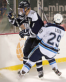 Damon Kipp (UNH - 4), Connor Leen (Maine - 29) - The University of Maine Black Bears defeated the University of New Hampshire Wildcats 5-4 in overtime on Saturday, January 7, 2012, at Fenway Park in Boston, Massachusetts.