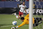 12 December 2008: Graham Zusi (11) of Maryland watches his shot on goal tipped away by Neal Kitson (1) of St. John's.  The University of Maryland Terrapins defeated the St. John's University Red Storm 1-0 during the second sudden death overtime at Pizza Hut Park in Frisco, TX in an NCAA Division I Men's College Cup semifinal game.