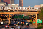 A Pink Line El train speeds over traffic on the Eisenhower Expressway on it's way out of Chicago, IL.