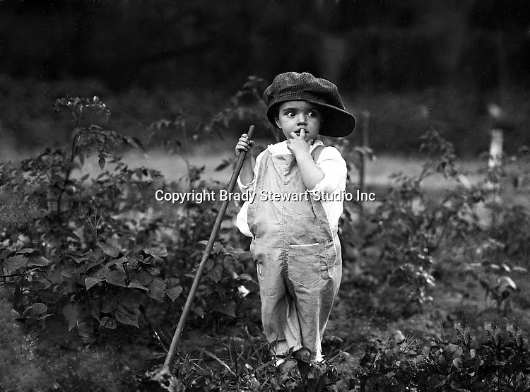 Point Breeze:  Helen Stewart helping Grandpa,  in  his Victory Garden - 1919.  During this time the Stewart's lived at 6705 Thomas Street in Point Breeze.