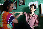 Kristen Vetter, a nurse and daughter of U.S. war veteran Larry Vetter, conducts physical therapy with La Thanh Toan, 21, in Da Nang, Vietnam. Toan and his brother Nghia, 18, are third generation victims of dioxin exposure, the result of the U.S. military's use of Agent Orange and other herbicides during the Vietnam War more than 40 years ago. The brothers were born healthy, but began to suffer from muscular dystrophy and other problems as they grew older. Now they are confined at home as their bodies and lives waste away. The Vietnam Red Cross estimates that 3 million Vietnamese suffer from illnesses related to dioxin exposure, including at least 150,000 people born with severe birth defects since the end of the war. The U.S. government is paying to clean up dioxin-contaminated soil at the Da Nang airport, which served as a major U.S. base during the conflict. But the U.S. government still denies that dioxin is to blame for widespread health problems in Vietnam and has never provided any money specifically to help the country's Agent Orange victims. Jan. 5, 2013.