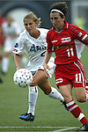 Nancy Augustyniak (left) and Marinette Pichon (11) at Villanova Stadium in Villanova, PA on 8/2/03 during a game between the Philadelphia Charge and Atlanta Beat. The Charge won the game 3-0.