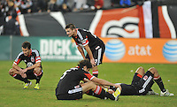 D.C. United players Perry Kitchen, Lewis Neil, Santos Maicon and Dejan Jakovic at the end of the game. D.C. United tied The Houston Dynamo 1-1 but lost in the overall score 4-2 in the second leg of the Eastern Conference Championship at RFK Stadium, Sunday November 18, 2012.