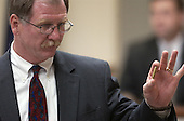 Prince William County (Virginia) assistant commonwealth attorney Richard Conway displays a shell casing found inside a Chevrolet Capris used by sniper suspect John Allen Muhammad during testimony in courtroom 10 at the Virginia Beach Circuit Court in Virginia Beach, Virginia on November 3, 2003.<br /> Credit: Lawrence Jackson - Pool via CNP