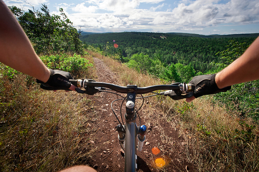 Point of view photography of mountain bike riding on the trails of
