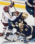 Quinn Smith (BC - 27), Eric Johnson (ND - 23), Steven Summerhays (ND - 1) - The visiting University of Notre Dame Fighting Irish defeated the Boston College Eagles 7-2 on Friday, March 14, 2014, in the first game of their Hockey East quarterfinals matchup at Kelley Rink in Conte Forum in Chestnut Hill, Massachusetts.