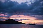 Rakiraki, Viti Levu, Fiji; the Fiji Siren liveaboard dive boat at sunset, anchored in front of the Volivoli Beach Resort