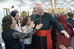 Cardinal Timothy Dolan, the archbishop of New York, greets parishioners at the end of a Mass in a displaced persons camp in Ankawa, near Erbil, Iraq, on April 11, 2016. The Mass concluded a three day visit by Dolan, chair of the Catholic Near East Welfare Association, to Iraqi Kurdistan with other church leaders to visit with Christians and others displaced by ISIS. <br /> <br /> CNEWA is a papal agency providing humanitarian and pastoral support to the church and people in the region.
