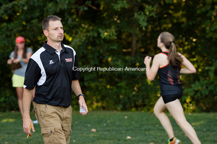 WATERTOWN, CT- 15 September 2015-091515EC09-  The new Watertown girls head coach, Brian LaFontaine, gives encouragement to runners at the finish line. LaFontaine was formerly assisting at Thomaston High School. The Watertown team swept the girls' race with first, second and third places. Erin Covey Republican-American