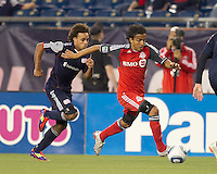Toronto FC midfielder Oscar Cordon (16) dribbles as New England Revolution defender Kevin Alston (30) closes. In a Major League Soccer (MLS) match, the New England Revolution tied Toronto FC, 0-0, at Gillette Stadium on June 15, 2011.
