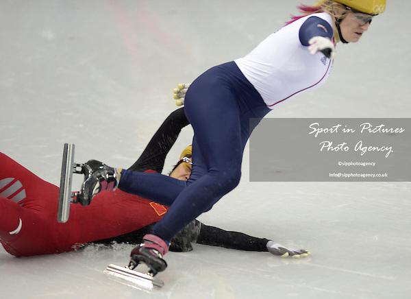 Jianrou LI (CHN) slips and takes out Ellise Christie (GBR) in the semi final. Womens 1000m - Short track skating - Iceberg skating Palace - Olympic Park - PHOTO: Mandatory by-line: Garry Bowden/SIPPA/Pinnacle - Photo Agency UK Tel: +44(0)1363 881025 - Mobile:0797 1270 681 - VAT Reg No: 768 6958 48 - 210214 - 2014 SOCHI WINTER OLYMPICS - Olympic park, Sochii, Russia