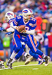 14 December 2014: Buffalo Bills quarterback Kyle Orton prepares to make a hand off in the third quarter against the Green Bay Packers at Ralph Wilson Stadium in Orchard Park, NY. The Bills defeated the Packers 21-13, snapping the Packers' 5-game winning streak and keeping the Bills' 2014 playoff hopes alive. Mandatory Credit: Ed Wolfstein Photo *** RAW (NEF) Image File Available ***