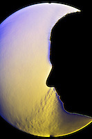 A schlieren image of a a man breathing through his nose.  The schlieren images identifies areas of different temperature by using the change in the index of refraction of a fluid due to a change in temperature.