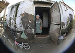 Maria Valle is seen in his flooded home in the Pachecas, near Jerez de la Frontera in Cadiz is pictured after it was closed on january 05, 2010 for the heavy rain. (c)Pedro ARMESTRE.