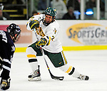 6 December 2009: University of Vermont Catamount forward Brett Leonard, a Junior from South Burlington, VT, takes a shot against the University of New Hampshire Wildcats at Gutterson Fieldhouse in Burlington, Vermont. The Wildcats defeated the Catamounts 5-2 in the Hockey East matchup. Mandatory Credit: Ed Wolfstein Photo