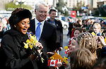 Her Excellency the Right Honourable Michaelle Jean, Governor General of Canada, receives daffodils from school children during her first visit to Victoria, British Columbia, at the Legislature on Tuesday March 7, 2006. The Governor General was greeted by Premier Gordon Campbell, a crowd of school children, aboriginal dancers, VIPs, veterans, Guard of Honour, and a 21-gun salute. Photo assignment for the Canadian Press (CP) news wire service. .