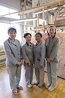 Four experienced artisan weavers at Oriental Carpet Mills, Yamanobe-machi, Yamagata, Japan, April 12, 2016. Oriental Carpet Mills was founded in 1935 and produces luxury hand-woven and tufted carpets. Its carpets are used all over the world, including in the Vatican, the Imperial Palace in Tokyo and the Kabukiza Kabuki Theatre.